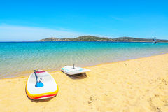 Surfboards on a golden beach in Porto Pollo. Sardinia Royalty Free Stock Image