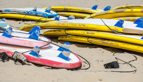 Surfboards. A number of colorful surfboards are stacked on the beach on the Dutch coast on a sunny day Stock Images