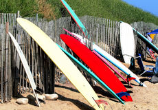 Surfboards resting up on a fence in Ditch Plains Stock Photography
