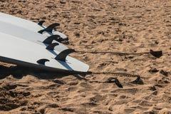 Surfboards on sandy beach Stock Photos