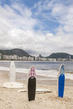 Surfboards standing upright the Copacabana Beach Stock Photo