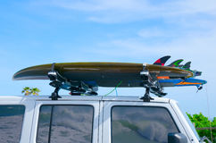 Surfboards on truck w wave reflections in windows Royalty Free Stock Photos