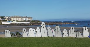 Surfboards and view to Kilkee beach in Ireland. Surfboards and view to Kilkee beach in county Clare in Ireland Stock Photos