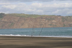 Surfcasting rods left at the beach. Surfcasting rods set at Whatipu beach, Auckland, New Zealand Royalty Free Stock Photos