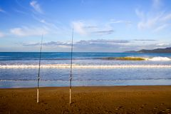 Surfcasting Rods at Taipa Beach. Surfcasting rods in the sand at Taipa Beach on a beautiful Summer evening, Northland, New Zealand Royalty Free Stock Image