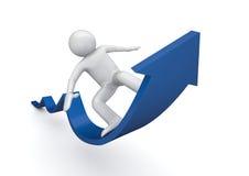 Surfen auf einen blauen Pfeil des Erfolgs Lizenzfreies Stockfoto