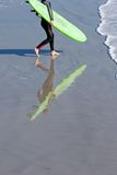 Surfer. With reflection Walking into the Water Stock Images