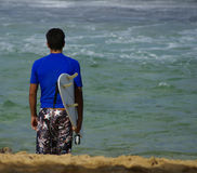 Surfer. With his surfing board at the beach Royalty Free Stock Photos