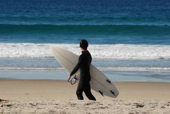 Surfer. A young surfer checking out the waves. Shot on the coast of San Diego, California Stock Photo