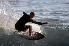 Surfer. Young man surfing Royalty Free Stock Image