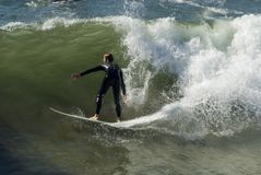 Surfer 2. A young man is surfing on a big wave in southern California Stock Image