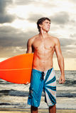 Surfer. Professional surfer holding a surf board Royalty Free Stock Photography