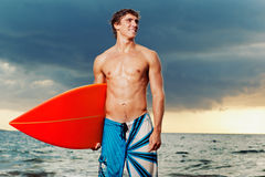 Surfer. Professional surfer holding a surf board Stock Photo