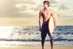 Surfer. Professional surfer holding a surf board Stock Images