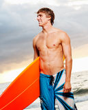 Surfer. Professional Surfer holding a Surf Board Royalty Free Stock Photo