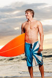 Surfer. Professional surfer holding a surf board Stock Photography