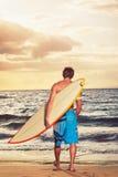 Surfer. Professional Surfer holding a Surf Board Stock Image