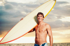 Surfer. Professional Surfer holding a Surf Board Stock Photos
