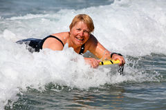Surfer. Female Boogie-boarder having fun in the surf Royalty Free Stock Photography