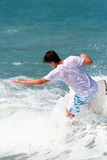 Surfer 3. A youth surfs the shoreline at the ocean Stock Image