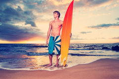 Surfer. On the beach at sunset in Hawaii Royalty Free Stock Photography
