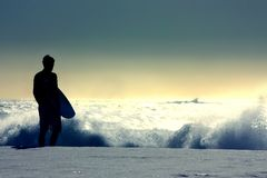 Surfer. Silhouette on the beach Stock Photography