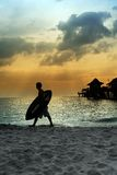 Surfer. A surfer's silhouette at the beach at sunset Royalty Free Stock Photos
