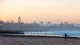 Surfer on Aberdeen beach at Sunset. Royalty Free Stock Images