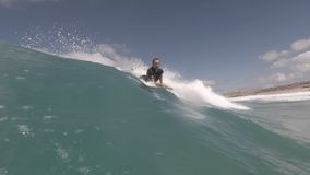 Surfer in action on the wave. Fuerteventura canary islands stock video