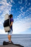 Surfer admiring the sea view Stock Images