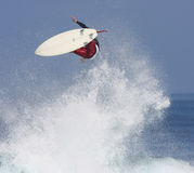 Surfer in the air. A surfer catches major air Royalty Free Stock Photo