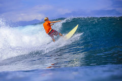 Surfer on Amazing Blue Wave Stock Photo