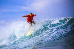 Surfer on Amazing Blue Wave Royalty Free Stock Image
