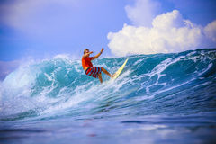 Surfer on Amazing Blue Wave Royalty Free Stock Photography