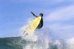 Surfer on Amazing Blue Wave. Bali island Stock Photo
