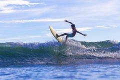 Surfer on Amazing Blue Wave. Bali island Stock Image