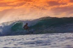 Surfer on Amazing Wave. At sunset time, Bali island Stock Photos