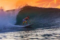 Surfer on Amazing Wave. At sunset time, Bali island Stock Images