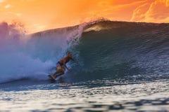 Surfer on Amazing Wave. At sunset time, Bali island Royalty Free Stock Photo