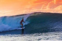 Surfer on Amazing Wave. At sunset time, Bali island Royalty Free Stock Image