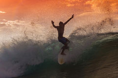 Surfer on Amazing Wave. At sunset time, Bali island Royalty Free Stock Photos