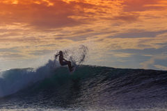 Surfer on Amazing Wave. At sunset time, Bali island Royalty Free Stock Images