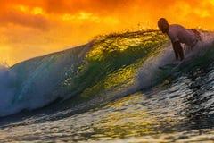 Surfer on Amazing Wave. At sunset time, Bali island Stock Image