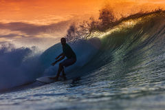 Surfer on Amazing Wave. At sunset time, Bali island Stock Photo