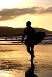 Surfer atSunset. Man with surfboard at sunset Royalty Free Stock Photo