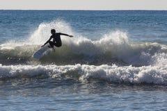 Surfer auf dem Strand von Recco in Genua Stockbild