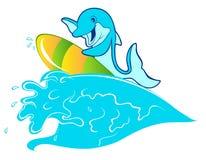 Surfer avec le dauphin Photo stock