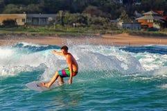Surfer at Avoca Beach, Australia. AVOCA BEACH,AUSTRALIA - JANUARY 17,2012: A surfer catches a wave on January 17,2012 in Avoca Beach, Australia Royalty Free Stock Photos