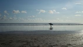 Surfer back home at Kuta Beach, Bali-Indonesia stock images