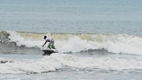 Surfer Bali Indonesia Surfing Slowmotion stock footage